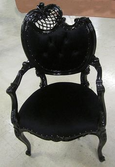 4215 BLACK LACQUER HOLLYWOOD REGENCY CHAIR  This black-on-black chair  is reminiscent of the elegance and sophistication of the regency period. The beautiful mahogany frame design was hand-carved with attention paid to every little detail, producing a masterpiece. While the shiny lacquer finish adds to to the glamor, the comfortable, black upholstery makes this chair not only great to look at, but also magnificently soft to sit on. It can be customized to make it truly unique and yours…