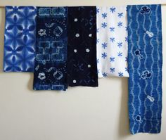 Indigo dyed Japanese folk textiles - the piece on the top, left, or bottom, center, is an itajime dyed diaper.  The six pointed sekka or snowflowers are configured into hexagon shapes which is kikko or the tortoiseshell pattern which means long life.
