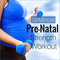 A pregnant lifting dumbbells and working out.