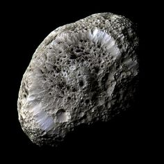 "Cassini image of Saturn's moon Hyperion. (Photo Credit: NASA/JPL) This moon that looks like a sponge is probably a fragment of a larger moon that broke up long ago. Mona Evans, ""10 Amazing Facts about Saturn's Moons"" http://www.bellaonline.com/articles/art28136.asp"