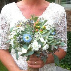 Beautiful Bride, pretty dress, fun flowers! First time adding succulents to a bouquet and it was a success!  #succulentwedding #succulentbouquet http://www.russwholesaleflowers.com/wholesale-succulent-sale  RusswholesaleFlowers.com offers the best wholesale succulent prices available to the public online.  wholesale succulents for bouquets, special events, wreaths, diy and more.  3 different sizes to meet your needs.