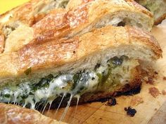 Scoop out the middle of a loaf of bread and fill it with: basil, parsley, arugula and mozzarella! Yes please?!