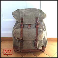 """Vintage Swiss Army Backpack -  Rucksack of the Swiss Military in the 1960s - Made of Leather and Canvas """"Pepper and Salt"""""""