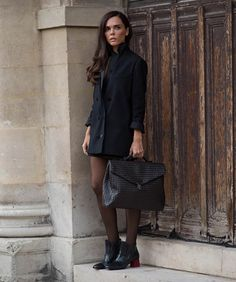 Evangelie Smyrniotaki. Her plumetis tights really create the perfect total black outfit http://dresslikeaparisian.com/how-to-wear-black/