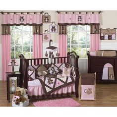 Give your little snuggle bear a nursery theme that fits her personality with this nine-piece feminine crib bedding set for girls from JoJo Designs. It features a contemporary pink and brown color scheme that will complement many baby furniture styles.