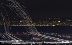 Awesome composite of 31 nighttime exposures of an hour worth of departures at San Francisco International Airport.