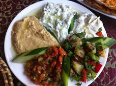 Maedah Grill - a selection of cold starters including humus, cacik (fresh yoghurt, with cucumber, fresh mint and garlic), patlican babaganus (grilled aubergine with green peppers, tomatoes, garlic in olive oil), and potato salad