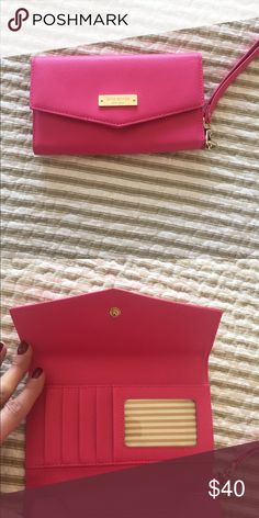 Kate Spade iPhone Wallet Clutch Wristlet Authentic Kate Spade IPhone Wallet Clutch Wristlet.          Color- Hot Pink w Gold accents. Used twice & excellent condition. kate spade Bags Clutches & Wristlets