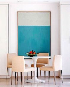 "Sometimes all you need is one statement piece to really transform a space. We love this vibrant, oversized abstract art. Find more art inspiration on our ""Statement Art"" Pinterest board via the link in profile! : @apartmenttherapy"