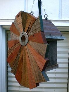 Flower-Patterned Rustic Birdhouse from Reclaimed Barn Wood and Metal Roofing. $120.00, via Etsy.