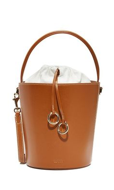 These are the best pieces fashion girls are buying right now. We're loving this tan bucket bag by Cafune