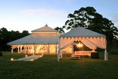 Elegant Outdoor Tents - Outdoor tents can be a beautiful focal piece for any event. Stunning details like billowy drapes, incredible lighting, and muted colors make this a magical occasion.