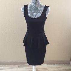 Sexy Black Peplum Dress NWT Gorgeous dress with zipper on back.     85% Polyester 12% Rayon 3% Spandex.   NO TRADES Love Ady Dresses