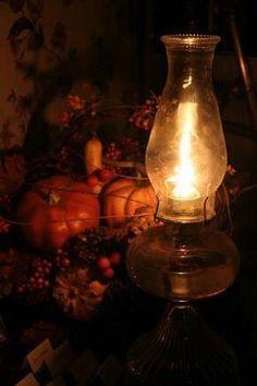 Still Life With A Lit Lantern Mini Pumpkins Berries