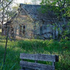 An old family homestead sits sadly alone and in ruin.  What memories must these walls still hold?