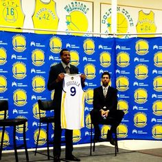 Andre Iguodala holds up his #Warriors No. 9 jersey for the first time.