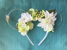 Flower and Garden Festival inspired Tinkerbell wire Mouse Ears are perfect for your day spent at the most magical place on Earth! Perfect for any Peter Pan or Tinkerbell enthusiast or an Tinkerbell-th