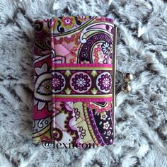 """Vera Bradley Very Berry Paisley Wallet Kiss lock wallet in very berry paisley. Tri-fold with kiss lock compartment for change. Pockets for cash and cards.  Condition: Gently worn.   ◆If you'd like more pics or have questions, ask! ◆If you'd like to make an offer, please use """"Offer"""" button. NO TRADES Vera Bradley Bags Wallets"""