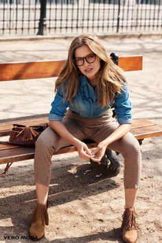 Wearing glasses, Josephine Skriver models denim shirt and checkered print pants