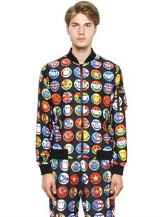 $459, Multi colored Print Bomber Jacket: Moschino Smiley Flags Printed Nylon Bomber Jacket. Sold by LUISAVIAROMA. Click for more info: https://lookastic.com/men/shop_items/321166/redirect