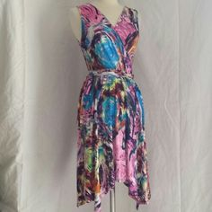 """🌹Colorful dress Very silky!!! Love the feel!!! Size small """"really fits most sizes!! Unique bottom  Is cut like high low but mostly on sides! Bought at local boutique  Only worn a few times Dresses High Low"""