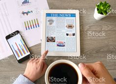 Business person drinking coffee and reading news on tablet pc royalty-free stock photo