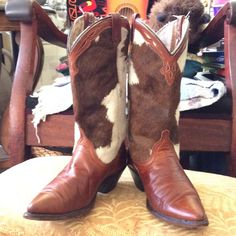 Dingo boots cowhide, 7.5 Beautiful great leather, much loved and worn. Heels great, no abrasions, tears to leather. Fur, hide, worn in spots although I did not notice til I checked for sale. A few strings apparent at top of boot from in and out use. I wear size 7-7.5 shoes and they fit and feel perfect but no size on boot Dingo Shoes