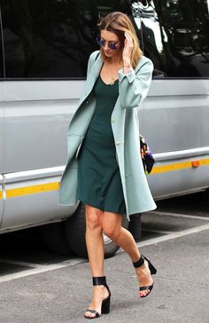 Photo via: NYTimes The going green trend is no longer just for tree-huggers! This street style stunner sports the stand out hue in a mint green jacket worn over a dark green dress with black ankle str