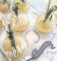 This might be the cutest way to serve holiday cocktails - in calligraphed ornaments! ✨ #regram via : @gritandgraceinc | @abbyjiu @laurynprattes @lhcalligraphy