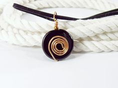 Black Agate Round Pendant with Copper Spiral on Black Cord, $19