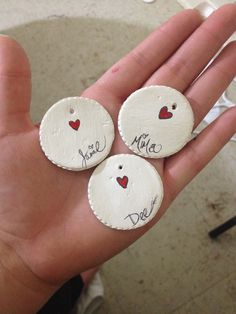 Homemade name tags for gifts for any occasion. I made them with air dry clay an painted the heart with acrylic paint. I wrote the names with a micron pen