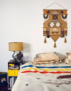 Headboards aren't always necessary, hang native wall art above your bed for a cool effect