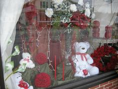 window displays many Valentine's Day floral arrangements and gifts