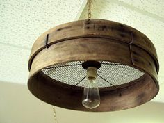Old grain sieve repurposed into a primitive chandelier - 26 DIY Vintage Decor Ideas.wonder if you could Old grain sieve repurposed into a primitive chandelier - 26 DIY Vintage Decor Ideas.wonder if you could do this with old cheese boxes. Rustic Lighting, Vintage Lighting, Rustic Chandelier, Hanging Chandelier, Industrial Lighting, Kitchen Lighting, Farmhouse Chandelier, Industrial Bedroom, Vintage Chandelier