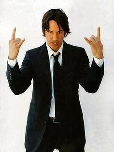 Keanu Reevesthrowin Horns Up 3