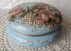 Antique~Limoges~ Elite S M France~ Powder Jar Circa 1896-1900~Hand painted piece~Sky blue and white background~Pink and white flowers~Green Leaves and embellished with gold accents
