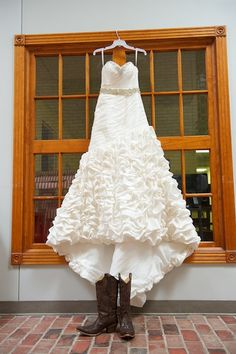 beautiful wedding gown with tons of ruffle detail paired with cowgirl boots - thereddirtbride.com - see more of this wedding here