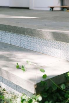 Concrete steps leading to a front porch are accented with blue mosaic tiles. Concrete steps leading to a front porch are accented with blue mosaic tiles. Front Porch Stairs, Front Porch Remodel, Front Door Steps, Front Porch Makeover, Porch Steps, Front Entry, Porch Swing, Porch Tile, Patio Tiles