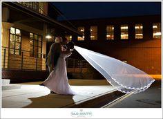 Wedding Sneak PeekKendall and Brad#charlotteweddingphotographer #charlotteweddingphotography #roofwithaview #charlotteweddings #southernweddings #carolinabride #twinklelights #seafoamgreen #coralflowers