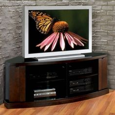 Enamour Corner Media Cabinet Style Modern Feature Espresso Varnished Wooden Corner Media Cabinet With Glass Door With Silver Television And Laminated Wooden Flooring Plus Black Dvd Player a part of  under Furniture