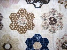 english paper piecing history | ... English paper pieced arranged in frame style layout. Center hexagon is