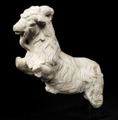 A Roman marble statue of a goat Circa 1st-2nd Century A.D. Shown leaping with his forelegs raised, now missing, with a long shaggy woollen fleece and beard, with a tuft of curls on the top of the head, the horns curving backwards.