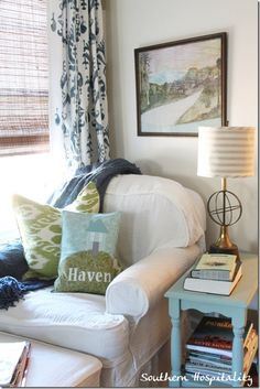 I'd love to have a cozy sitting area in my bedroom someday...  That's the perfect place to curl up and read...  Or pin things!