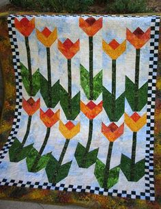 Looking for your next project? You're going to love Tulip Garden by designer bdieges. - via @Craftsy