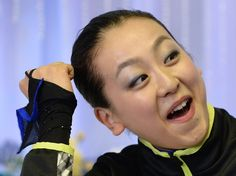 Mao Asada of Japan reacts after her performance during the women's free skating event in the NHK Trophy, the fourth leg of the six-stage ISU...