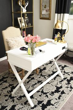 A review of the Nourison Graphic Illusions Black Damask Area Rug from Rug Studio. The rug looks gorgeous in this black, white and gold glam home office.   via http://monicawantsit.com