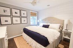 bedroom: paneled walls, b&w prints, upholstered headboard...