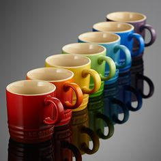http://www.kitchenredesignideas.com/category/Le-Creuset/ Le Creuset - mugs in every color.