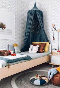In love with this room! Bright and full of fun, modern scandi vibe. Numero74 products in here: Teal Blue Canopy, Teal Blue Summer Blanket (on the bed).