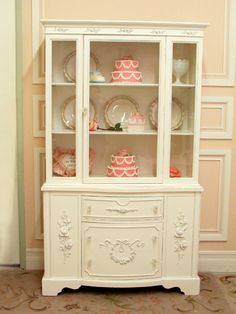 I love the whole feminine look of this cabinet but it may be too girly for my kitchen.